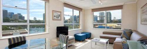 Two Bedroom Lounge with Harbour View - Harbourside Apartments Sydney